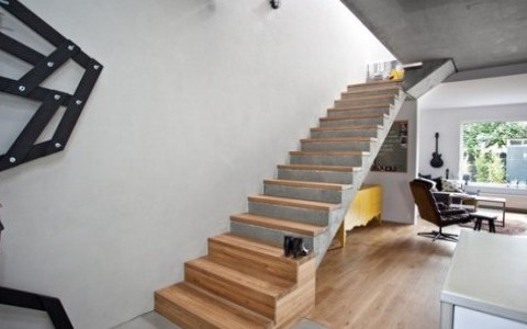 Casual-Concrete-House-Design-With-white-wall-and-wooden-stair-and-floor-and-chiar-table-and-big-window-554x300-1